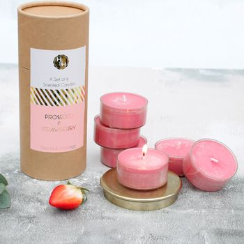 A Set Of Six Fizz And Strawberry Candles