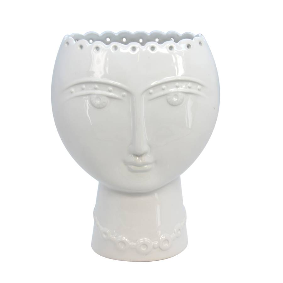 modernist white vase by the contemporary home