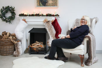 Faux fur stockings by the fire