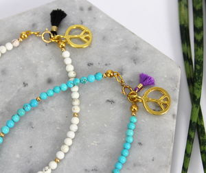 Stone Bracelet With Gold Peace Charm