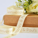 Cream 25mm personalised anniversary ribbon with matt antique gold print