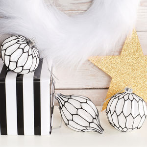 A Set Of Black And White Glass Baubles