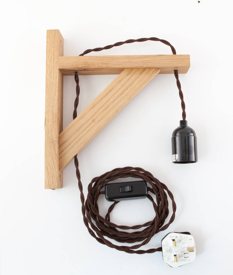 hebden oak wall bracket beside lamp wall light by dowsing & reynolds notonthehighstreet.com