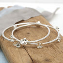 Handmade sterling silver flower bangle
