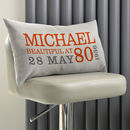 grey cushion - orange & grey text