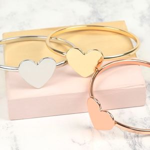 Set Of Mixed Metal Heart Bangles