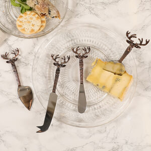 Set Of Four Hammered Copper Stag Cheese Knives
