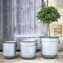 Distressed Metal Planters In Three Sizes