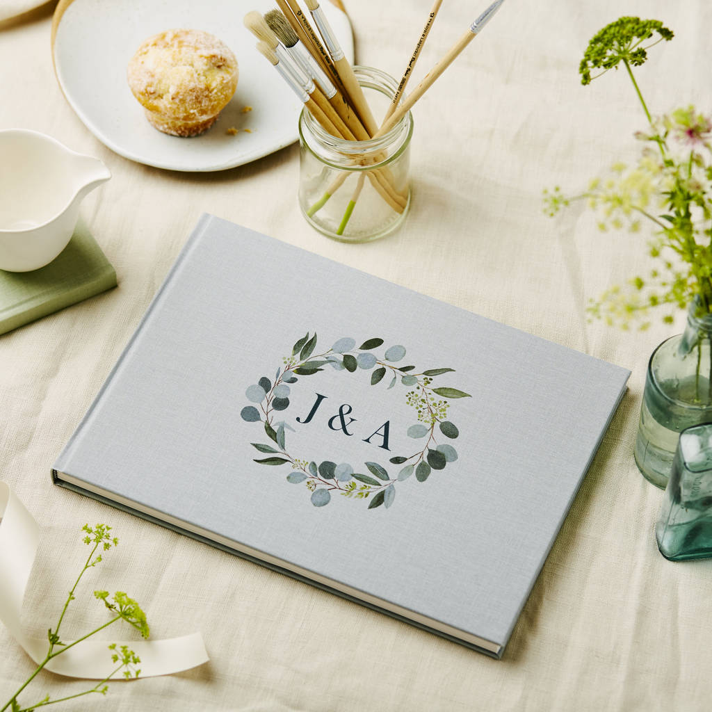 personalised fabric covered wedding guest book by