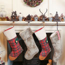 Set Of Four Patchwork And Faux Fur Christmas Stockings