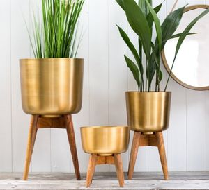 Brass Plant Pot On A Wooden Stand - new in garden