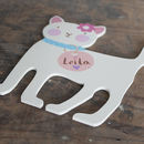 cream birch plywood cat door sign that is hand cut and hand painted