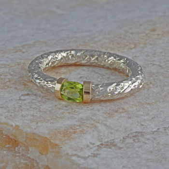 Tension Set Peridot In A Textured Silver Band