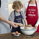 Personalised 'In Charge Of' Apron Child And Adult Set