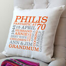 cream cushion - orange & grey text