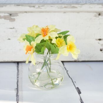 Artificial Daffodils In Glass Vase