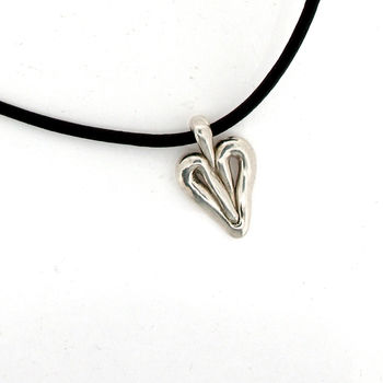 Silver heart pendant on leather