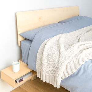 Floating Bed With Foldout Bedside Table