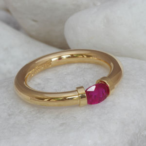 18 Carat Gold Tension Ring Set With A Ruby - rings