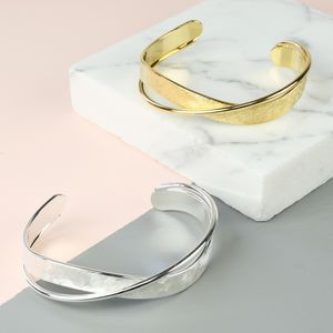 Brushed And Shiny Crossover Bangle - jewellery
