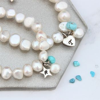 mother and daughter white pearl bracelet personalised with a silver letter charm and turquoise birthstone for December