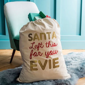 'Santa Left This For You' Name In Lights Christmas Sack - christmas decorations