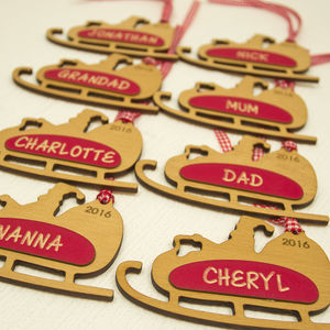 Eight Personalised Father Xmas Sleigh Tags