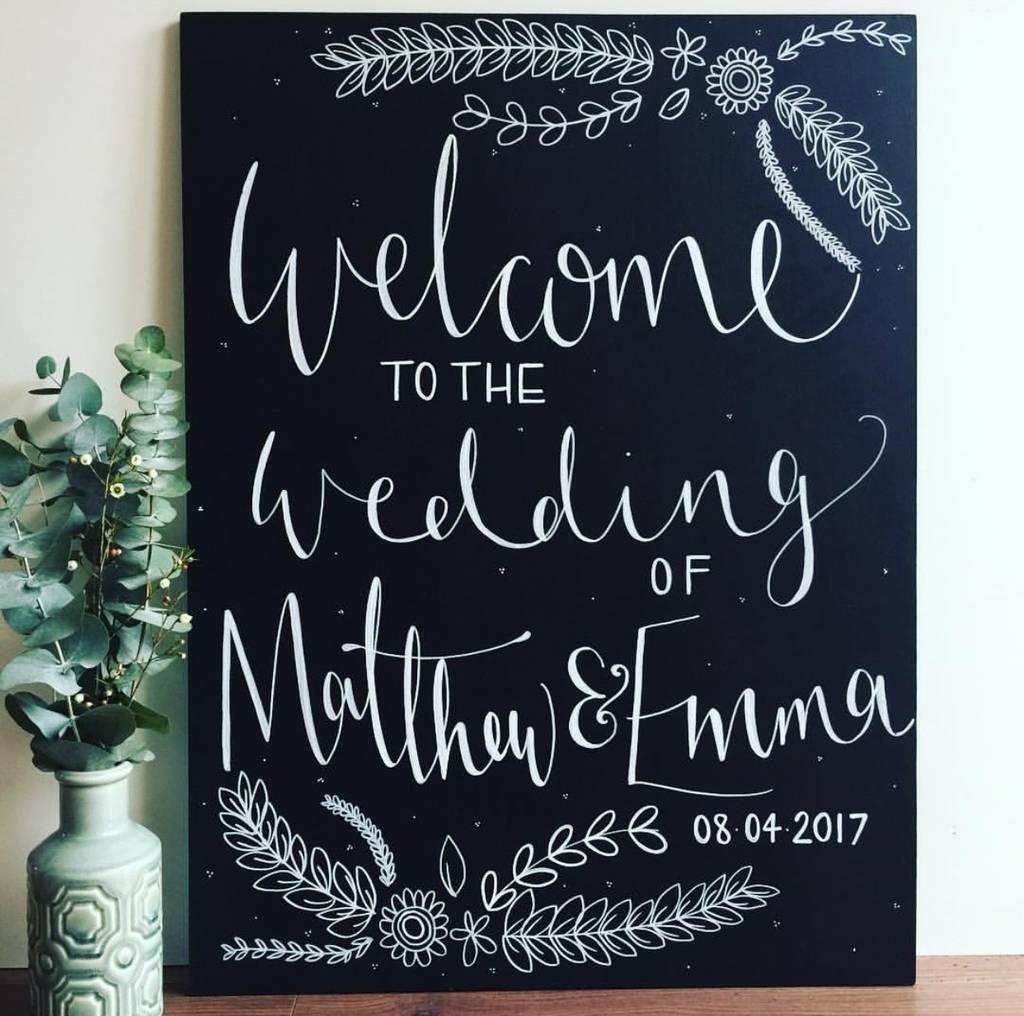large floral welcome chalkboard sign by mee and es designs
