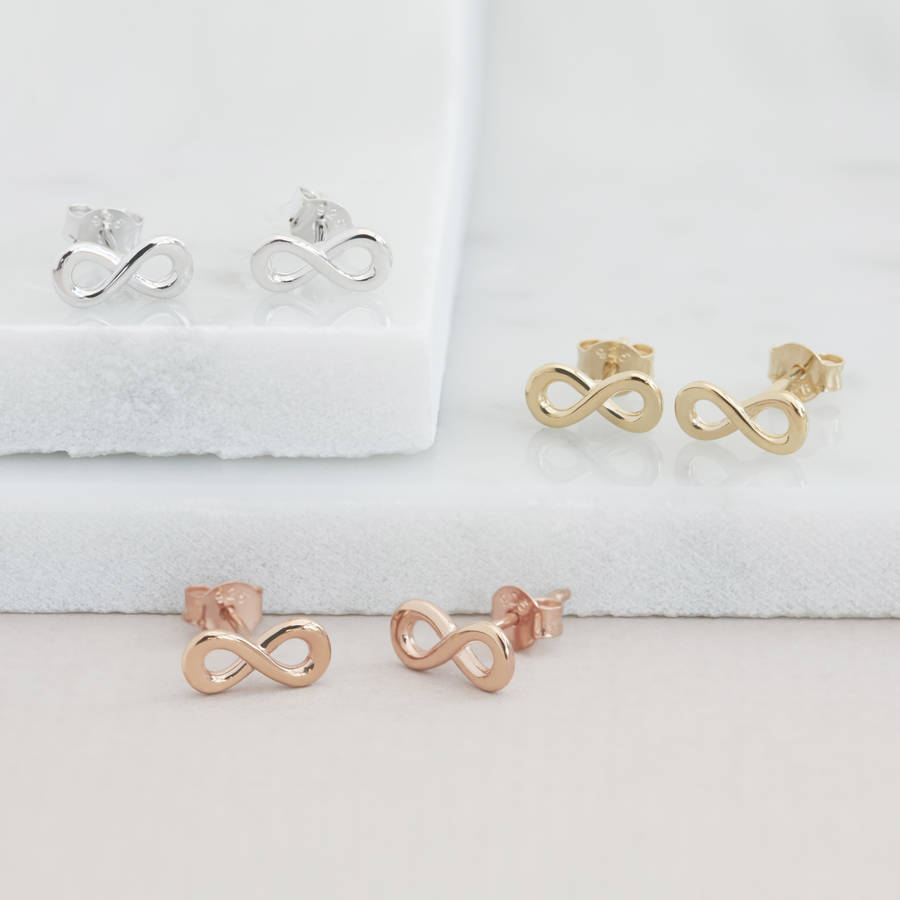 earrings infinity orelia lyst in gold tiny jewelry featured metallic stud