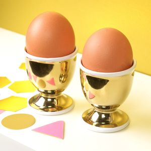A Set Of Gold Egg Cups - kitchen