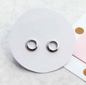 Karma Hollow Stud Earrings - earrings