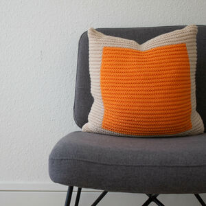 Hand Knit Colourblock Cushion In Ecru And Orange