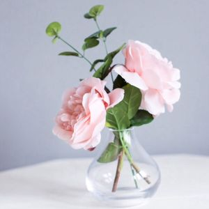 Faux Roses With Eucalyptus In A Vase