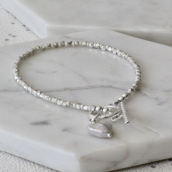 Faceted Silver And Cream Seed Bracelet
