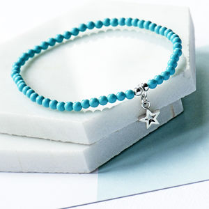 Elasticated Blue Ball Bracelet With A Star Charm - whatsnew