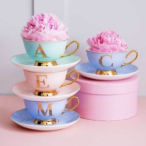 Pastel And Gold Letter Cup And Saucer Set - kitchen