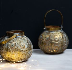 Burnished Lanterns With A Filigree Design