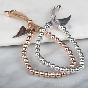 Polished Silver Or Rose Gold Bracelet With Leather Cord