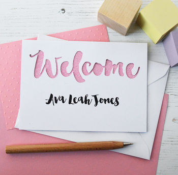 White with bright pink glitter welcome baby cut out card
