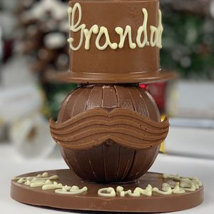 Terry's Orange Hat And Tash On A Chocolate Round - chocolates
