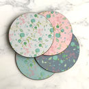 A Set Of Four Floral Pattern Coasters