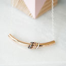 Curved Gold Bar Necklace With Rings