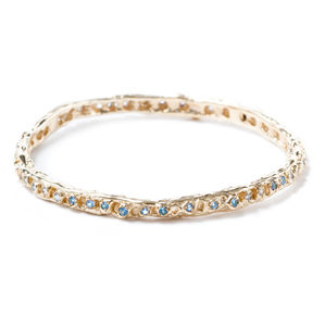 Gold Bangle With Light Blue Sapphires