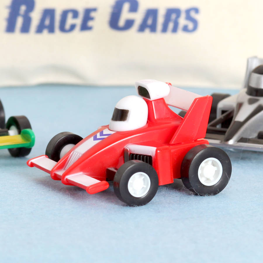 Toy Race Trucks : Three toy race cars with personalised cotton bag by red
