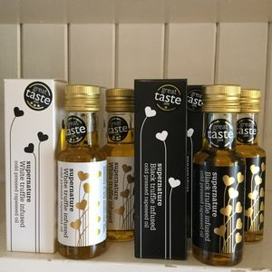 Two Black And Two White Truffle Oil Packs