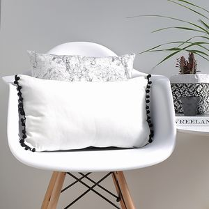 White And Black Pom Pom Cushion - living room