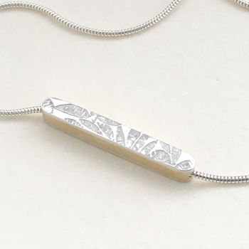 'petals' embossed silver with brass bar necklace