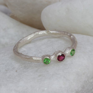 A Three Stone Pink And Green Garnet Ring