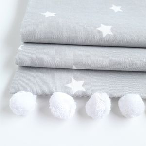 Grey Stars Roman Blind With Pom Pom Trim - baby's room