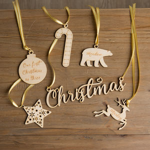 A Set Of Six Personalised Christmas Wooden Baubles